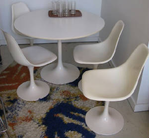 Eero Saarinen-inspired table and chairs like the ones we had growing up.