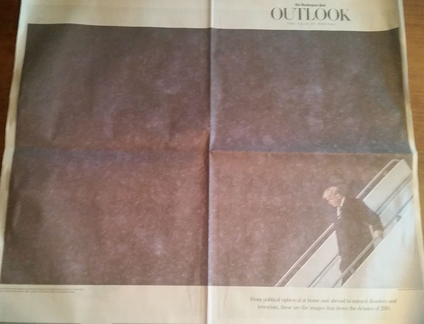 Washington Post Outlook section, dated 1/20/2017. Trump appears below the fold in an image that covers the front and back of the Outlook section. Trump is leaving Air Force One on the jetway stairs..